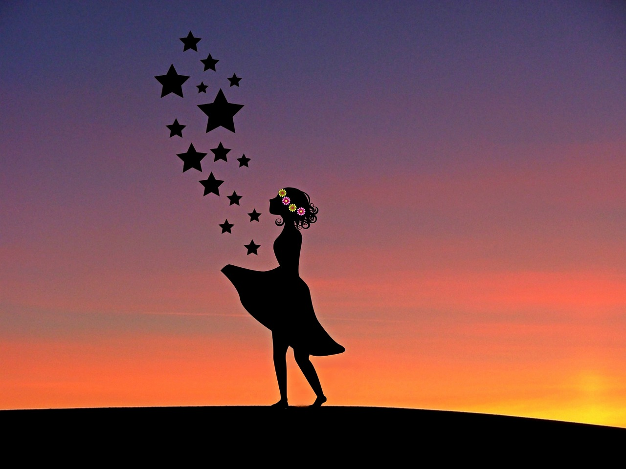 Silhouette of girl with stars rising to the sky