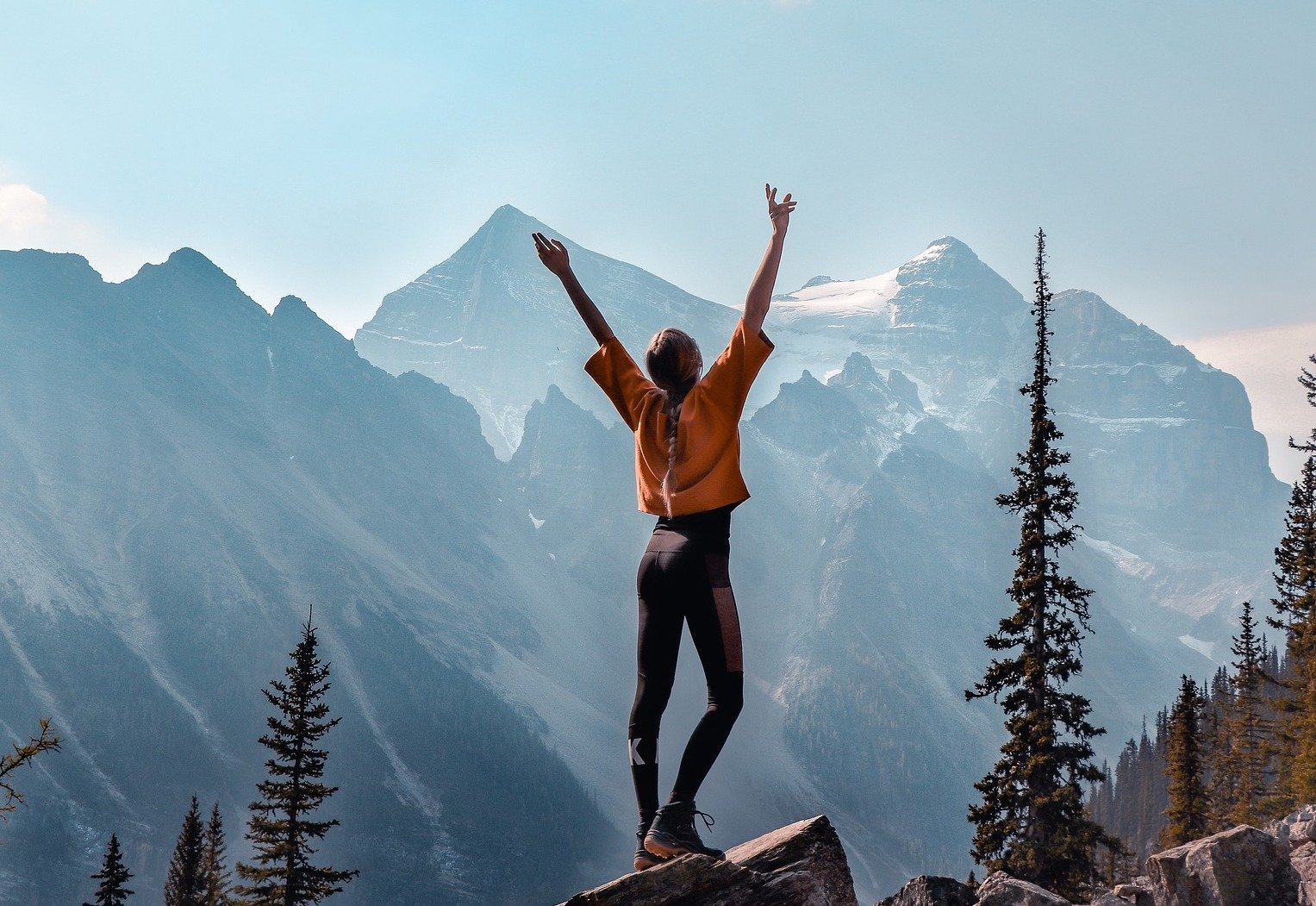 Girl celebrates reaching the highest part of a mountain